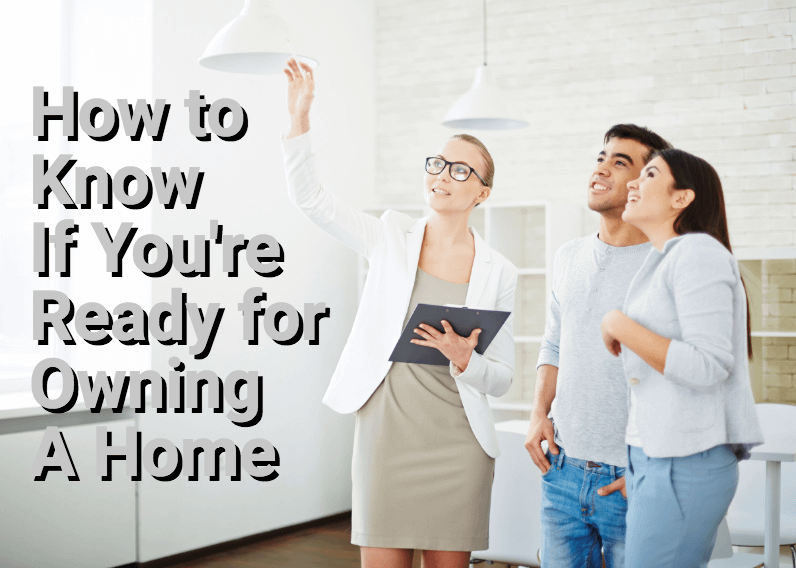 Young couple looking at home with real estate agent