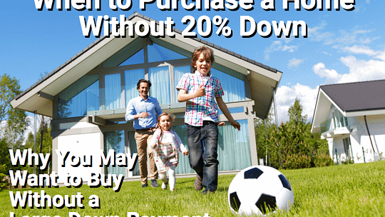 Happy family playing soccer on lawn in front of house