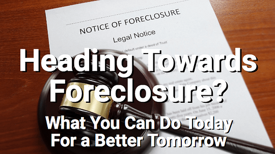 Foreclosure papers with gavel on table