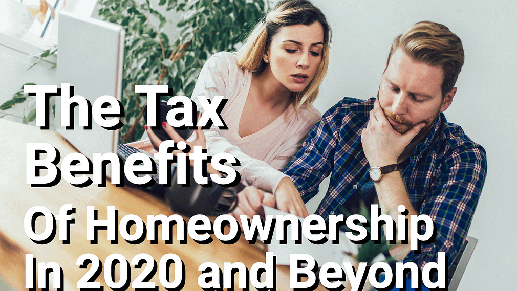 Couple doing taxes at home table