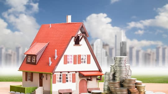 Toy house with money. Investment concept