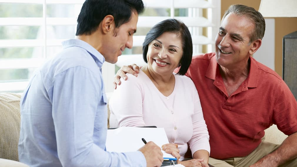 Couple meeting with loan agent