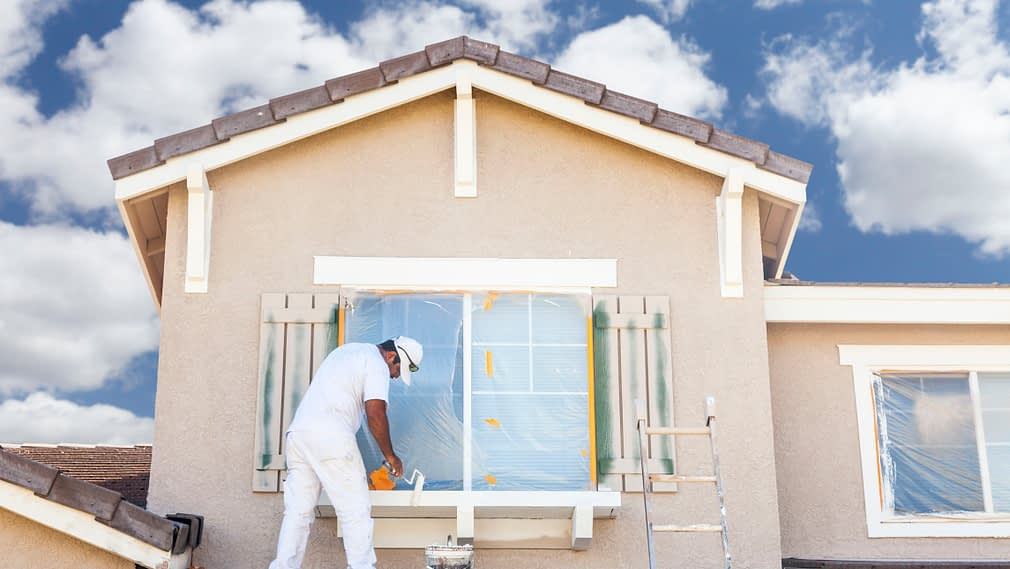 Busy House Painter Painting House